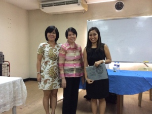 Dr. Romylyn Metila receives a certificate from Dr. Leonor Diaz and Dean Rosario Alonzo of the UP College of Education